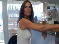 Horny German Step Mom in her Kitchen Thumb