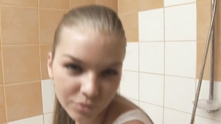 Lovable Euro teen showering and showing cage Thumb