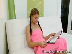 Young Anal Tryouts - Anna sits quietly in her sexy pink outfit Thumb