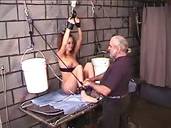 Young Nicole hangs bound to the dungeon wall and prodded with metal object Thumb