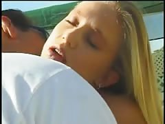Young cute blonde whore deep throats a hard cock in front of pool Thumb