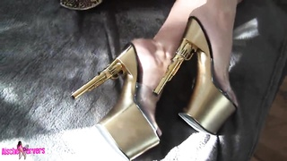 Young hooker in high shoes spreads her stems and jerks off Thumb