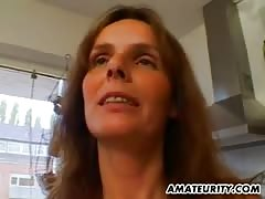 Hot amateur Milf gets fucked in her kitchen Thumb