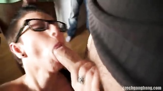 Big-boobed cutie in sexy glasses is being drilled in precisely the gang bang fashion Thumb