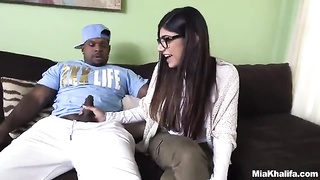 Dame Mia Khalifa offers a hand job to a hung ebony dude for starters Thumb