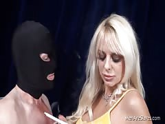 Hot blonde forces men with mask to smoke Thumb