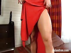 Hard muscles and a big clit in a sexy red dress Thumb