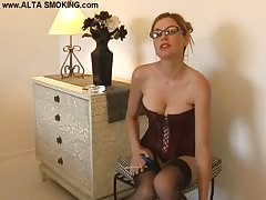 Busty lady in corset is enjoying smoking and fetish! Thumb