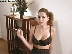 Beauty in sexy black lingerie is definitely enjoying smoking Thumb