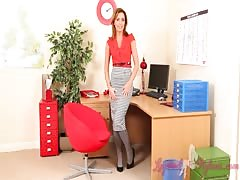Alluring beauty in nylons slowly undresses in the office Thumb