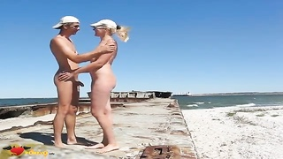 Astonishing nudist blond is crouching down and taking a boners Thumb