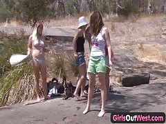 Young lesbian foursome outdoor bathing Thumb