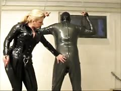 Hardcore mistress humiliating her submissive slave using whip Thumb