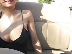 Spicy as hell blonde poses in her awesome black dress Thumb