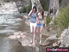 Girls Out West - Amateur lesbians playing by the river Thumb