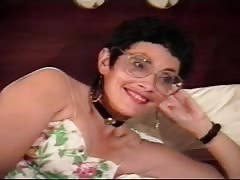 Kinky short-haired mature in glasses is performing a nice hot blowjob Thumb