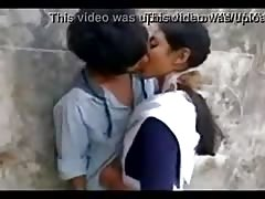 Indian school girl with hot kiss in outdoor Thumb