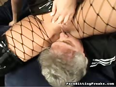 Big-breasted domina posing and smother her slave's face Thumb