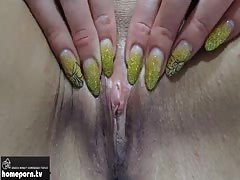 Babe with the sexy nails is showing her naked shaved pussy Thumb