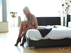 Inked blonde is blowing her lover's dick with force and passion Thumb