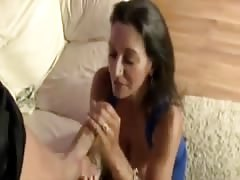 Sexy MILF tugs cock and flashes her bits Thumb