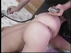 Brunette ass pumped with machine Thumb