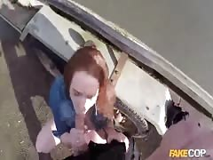 Redhead whore is being drilled hard by a perverted fake cop Thumb