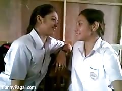 Two Indian School Girl Kissing In Class Thumb
