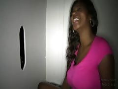 Ebony is sucking a huge black cock in the video by the Gloryhole Swallow Thumb