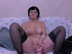 Big-breasted brunette mature is blowing a juicy rubber dick in the bedroom Thumb
