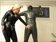 Mistress in latex spanking his ass in a hardcore BDSM action Thumb