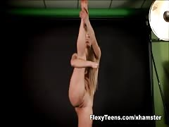 Flexible blondie shows naked gymnastics Thumb