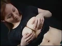 Asian woman squirts milk from her tits Thumb