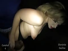 Blonde drinks cum out of a condom in the video by the Gloryhole Swallow Thumb