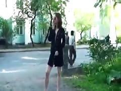 Russian brunette flashes next to a living house Thumb