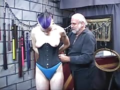 BDSM goth chick gets bound, spanked and nipples pinched by two men in chamber Thumb