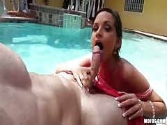 Dick-sucking angel is giving an amazing blowjob in the pool Thumb