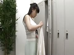Black-haired Japanese babe gets topless in the changing room Thumb