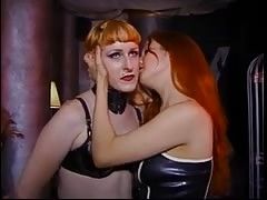 Two leather dominas lick each other's twats Thumb