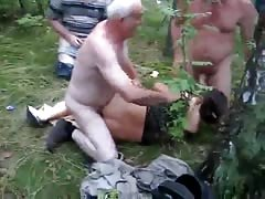 Dirty lustful girl gets fucked by two guys in the woods Thumb