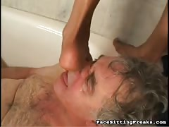 Tattooed ebony smothering her slave in bathroom! Thumb