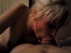Bleached Russian babe is blowing a dick in the close-up Thumb