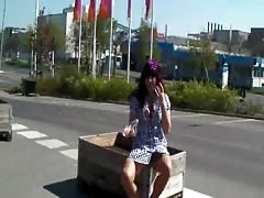 Brunette spreads her legs in the street and masturbates with a dildo Thumb
