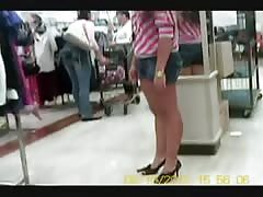 Leggy Asian Teen tries on a pair of new heels  CANDID Thumb