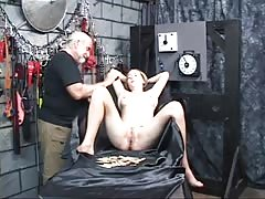 Cute bound girl has clothespins clipped all over her cunt in bondage dungeon Thumb
