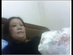 Chinese MILF plays with her tits Thumb