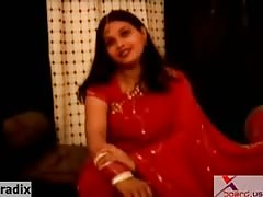 chubby fat indian aunty in red sari Thumb