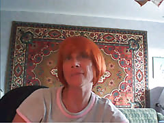 Redhead mom is reveling her massive natural boobs! Thumb