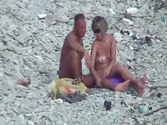 Voyeur. Guy with tanned ass fuck a woman at a public beach Thumb