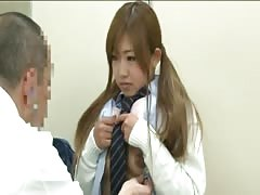 Orietal schoolgirl came to the doctor for medical examination Thumb